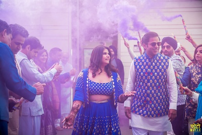 The bride and and groom are welcomes with smoke bombs at their mehendi ceremony!