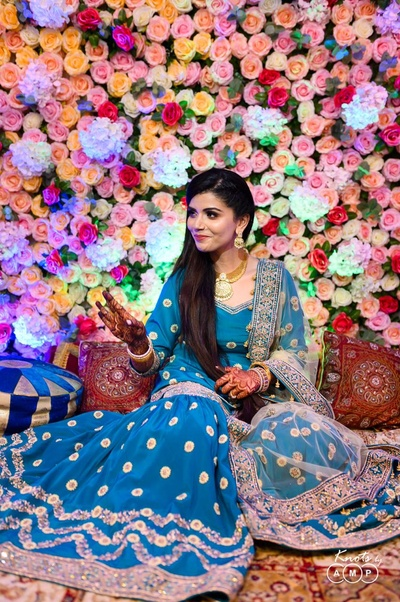 Ain wore a gorgeous teal blue gharara with a lemon-coloured dupatta for the Satim Doh ceremony.