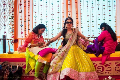 Dressed in a mixed match floral lehenga by Anushree Reddy for the mehendi ceremony