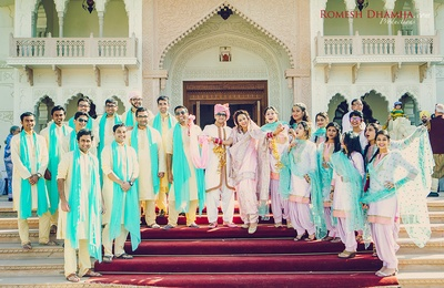 Groomsmen and Bridesmaids Dressed up brilliantly in color coordinated outfits for the Sikh Wedding.