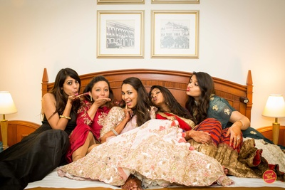 Bride and bridesmaids pose in a candid shot