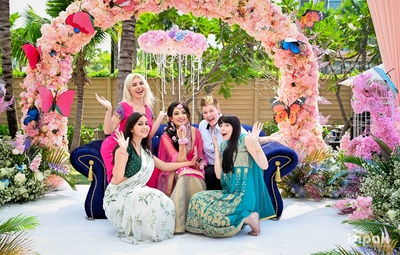The bride poses with friends at the mehendi ceremony!