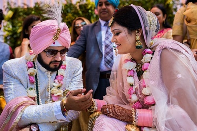 a candid capture of the bride and groom during the pheras