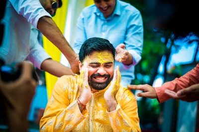 groom in a yellow kurta for the haldi ceremony