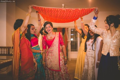 Megha enters for the sangeet ceremony.