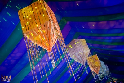 Canopy style drapes cabana setup for the couple's sangeet ceremony with strings and chandelier