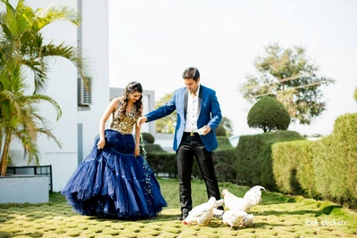 Navy blue ball gown with gold embroidered bodice