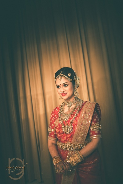 cute bridal portrait with temple jewellery and sabyasachi saree