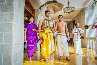 Yellow cotton lungi embedded with gold border is a traditional outfits for marriage among the South