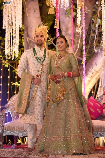 This couple strikes a stunning pose, looking nothing less than royalty!