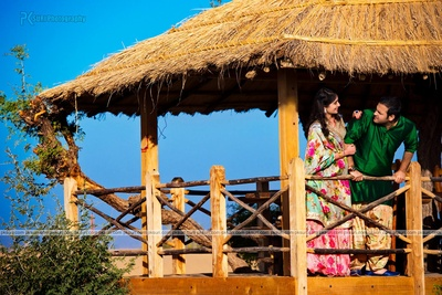 Dressed in ethnic outfits for their personalized destination pre wedding photo shoot