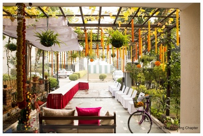 Entrance decorated with a mesh style ceiling, floral hangings and topiaires