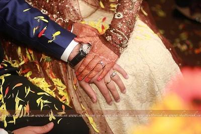 Diamond studded silver and platinum wedding rings