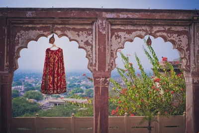 Deep red classic wedding lehenga embellished with gold floral thread worked embroirdery by Shymmal and Bhumika