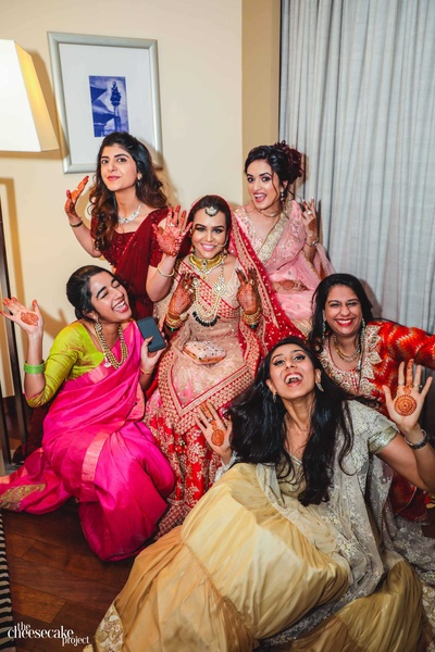 The everglowing bride with her band of bridesmaids