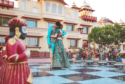 Bride and groom pose together on the giant chess board on display at the venue