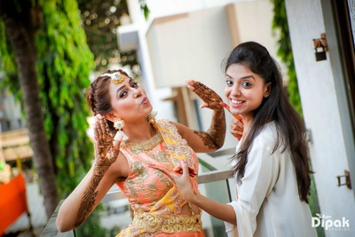 Bride and her bridesmaid posing during the mehndi function