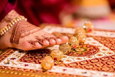 Bride following the Haldi rituals