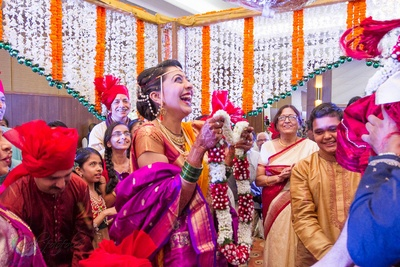 Gleaming with joy, for the Varmala ceremony