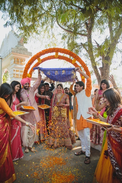 Bridal entry with lots of love and genda phool .