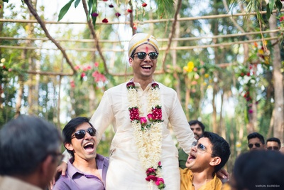 Goan groom in off white outift with safa in forest wedding held at Goa