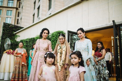 Entering the wedding ceremony with her bridesmaids.