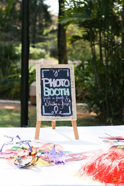 Photo booth stations at the pre wedding pool party.