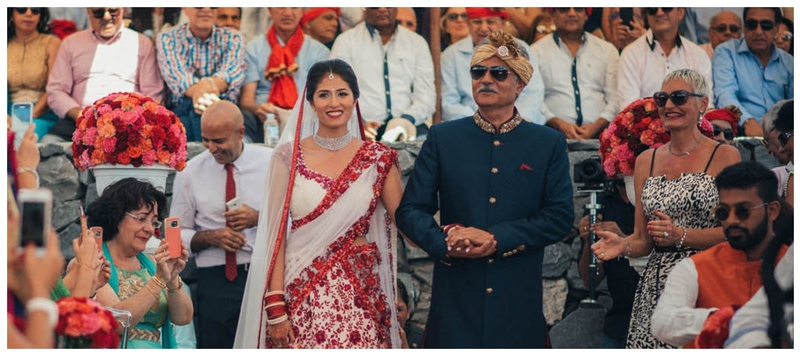 Jiten  & Romina Tenerife : This bride's choice of white and red minimalistic lehenga is breaking all the wedding rules!