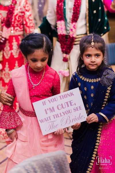 Little kiddos golding up signages to welcome the bride!