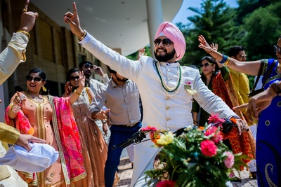 the groom making a statement entry on his Royal Enfield