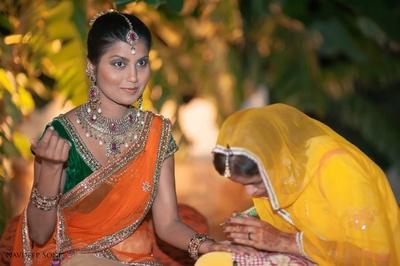 Green and kesari lehenga with jadau diamonds and rubies studded necklace set enhanced with bronze highlighter