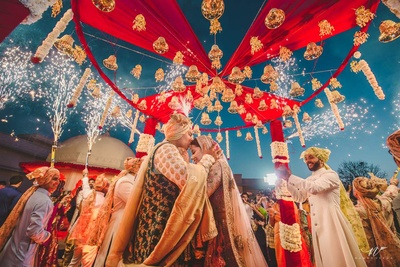 Creative and unique bridal photography of the couple underneath their mandap