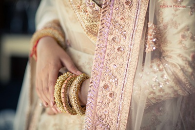 Close up of the bride's embroidered dupatta and embellished bangles