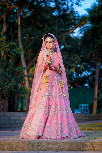 This bride has donned a gorgeous baby pink lehenga with silver emebellishments!