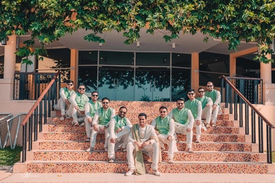 Groom and his groomsmen posing together in a quirky shot