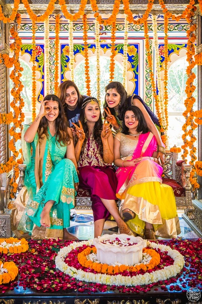 The bride with her bridesmaids at her mehendi ceremony