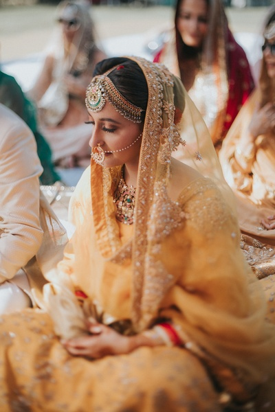 The bride sitting in prayer at her Anand Karaj ceremony.