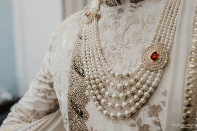 Prashant completed his wedding outfit with a ruby-studded layered necklace