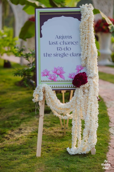 Traditional yet quirky signage at the wedding function