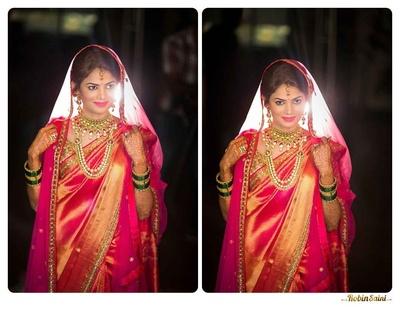 Rust orange and pink dhoop chhaon silk navaari saree, styled with a fuchsia sheer embellished dupatta