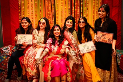 the bride and her bridesmaids at the mehendi ceremony