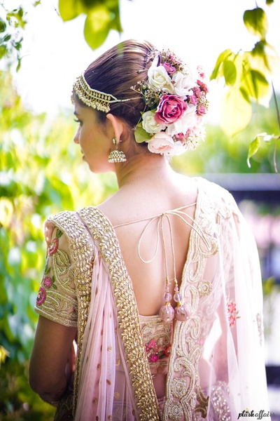 bridal blouse and bun design for the wedding ceremony