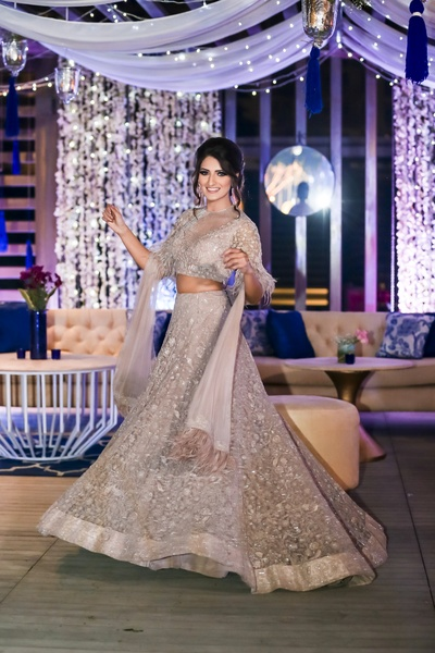 We cannot get our eyes off this beautiful bride twirling in her silver lehenga!