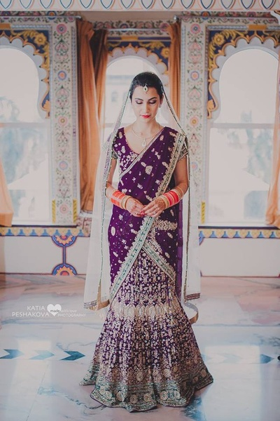 Wearing deep purple fishtailed lehenga with gold and silver thread work styled with minimal diamond jewellery.