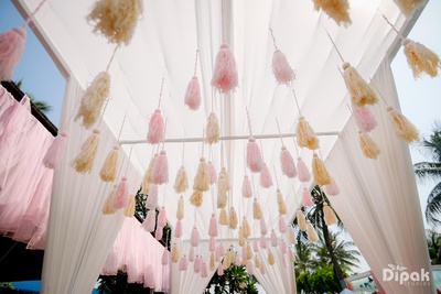 Beautiful , dual-coloured tassels used as ceiling hangings go well with the subtle hued drapes