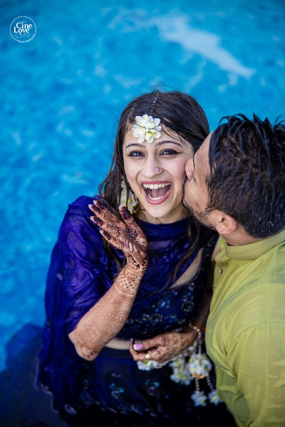 The couple having a blast at the mehendi pool party!