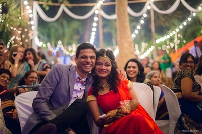Goan pre wedding in an unique formals with a bow and bright coloured lehenga