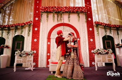 Bride and groom exchange varmala during the wedding ceremony at JW Marriott, Chandigarh