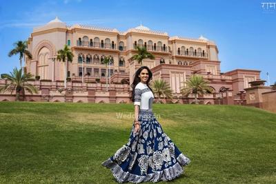 Bride Anushka twirls in her blue and white lehenga