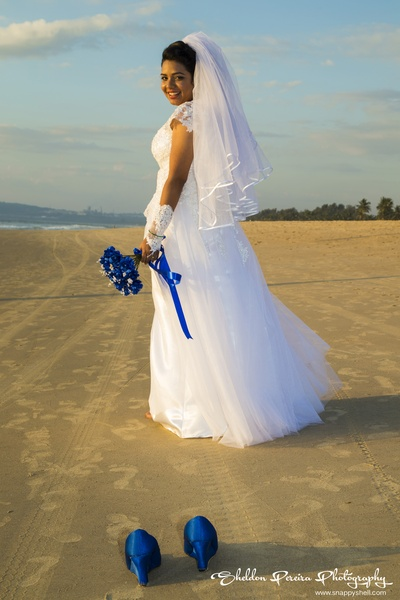 Lace and net, white A-line wedding gown worn with royal blue heels